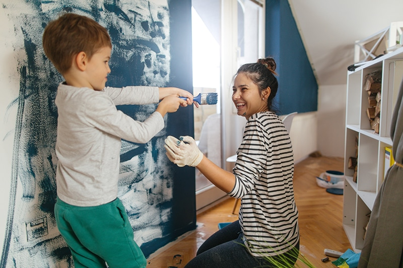 Mother and son painting walls